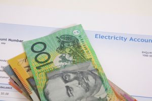 Electricity bill with money on top